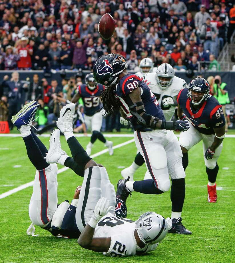 Houston Texans defensive end Jadeveon Clowney (90) intercepts a pass by Oakland Raiders quarterback Connor Cook during the first quarter of an AFC Wild Card Playoff game at NRG Stadium on Saturday, Jan. 7, 2017, in Houston. ( Brett Coomer / Houston Chronicle ) Photo: Brett Coomer, Staff / © 2017 Houston Chronicle