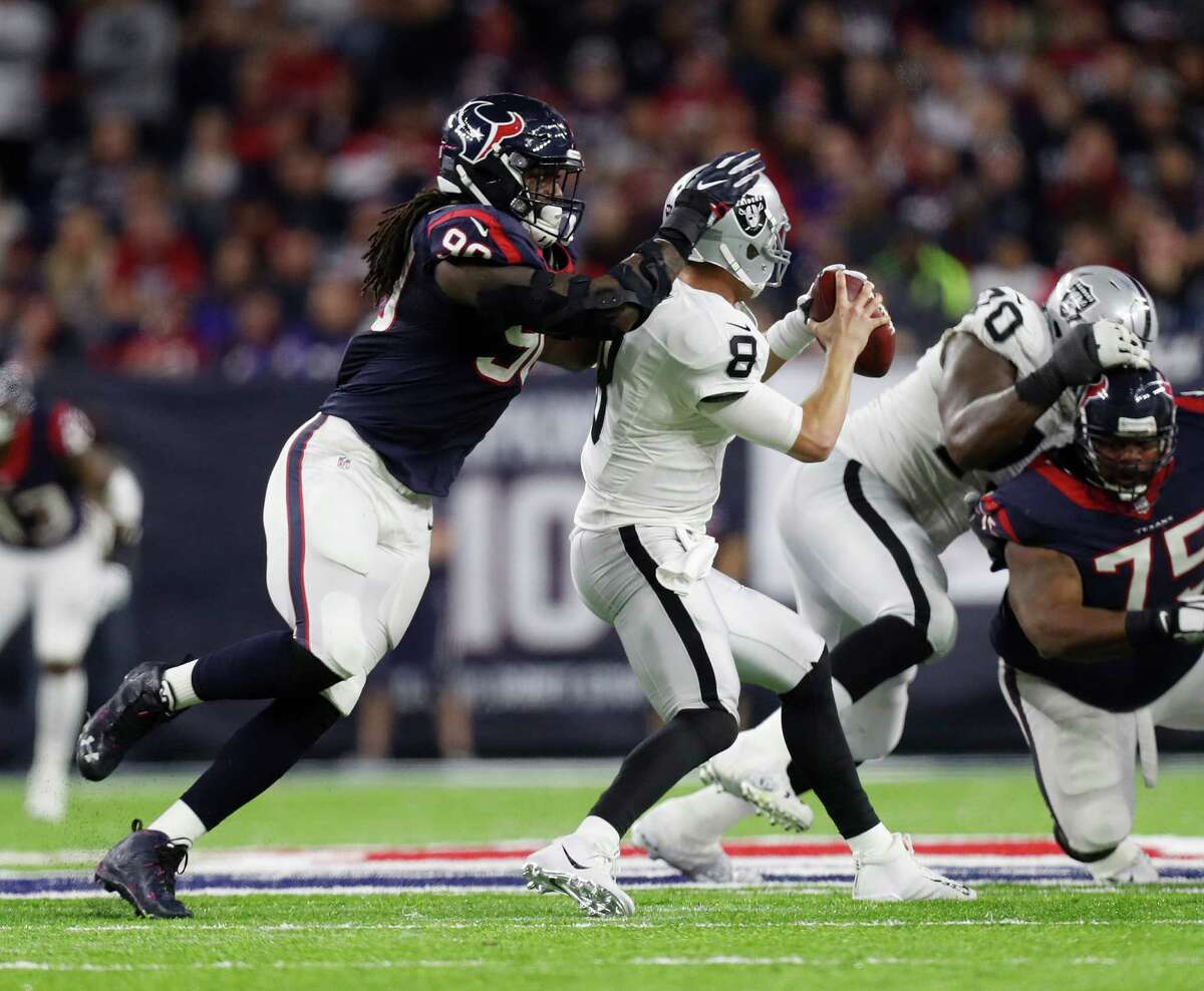 Texans defensive end Jadeveon Clowney closes in on Raiders quarterback Connor Cook during the fourth quarter of Saturday's game.
