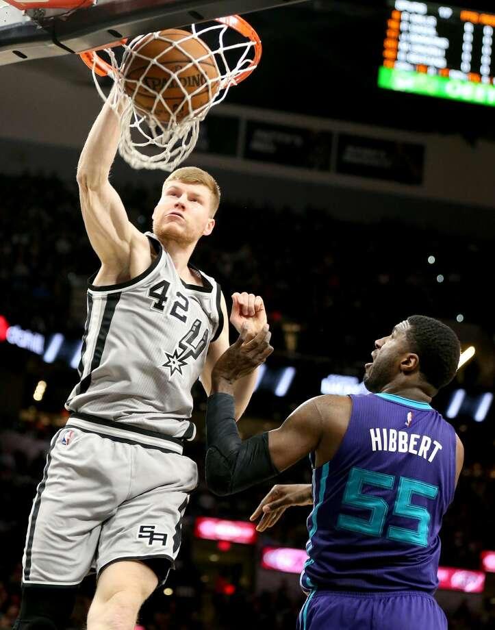 San Antonio Spurs' Davis Bertans dunks around Charlotte Hornets' Roy Hibbert during first half action Saturday Jan. 7, 2017 at the AT&T Center. Photo: Edward A. Ornelas/San Antonio Express-News