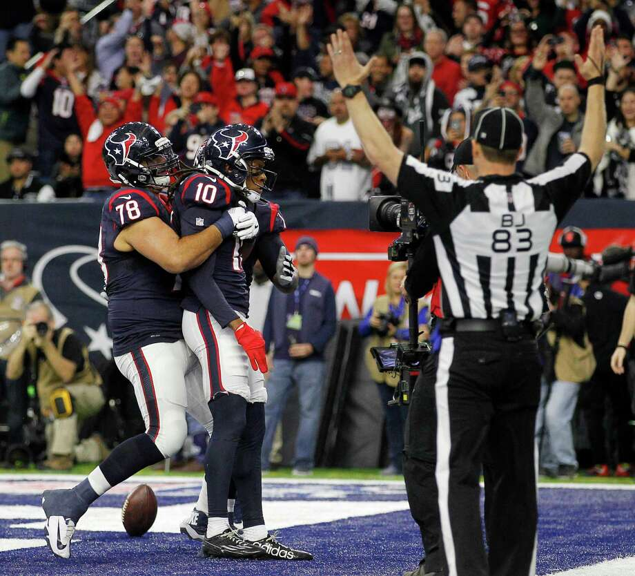 Texans wide receiver DeAndre Hopkins s hugged by guard Oday Aboushi (78) after scoring a touchdown in the second quarter. Photo: Jon Shapley, Staff / © 2015  Houston Chronicle