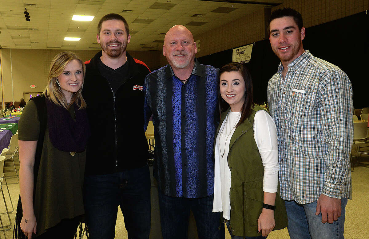 Courtney, Tommy, and Kirk Gillespie, Allison Landry, and Chris Gonzales were at the fifth annual Beans and Jeans fundraising party held Saturday night at the Bob Bowers Civic Center in Port Arthur. The event coincides with Three Kings' Day, which officially ends the Christmas season and kicks off the start for Mardi Gras season. Revelers got in the spirit, celebrating with red beans and rice, king cake and musical entertainment by Electric Circus as the Krewes for this year's 25th Mardi Gras of Southeast Texas were introduced. The season reaches its climax with the weekend-long party and parades in downtown Port Arthur that begins February 23. Photo taken Saturday, January 7, 2017 Kim Brent/The Enterprise