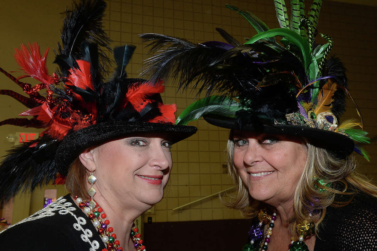 JoJo James and friend Debi Tamez made their decorative hats to join in the festivities at the fifth annual Beans and Jeans fundraising party held Saturday night at the Bob Bowers Civic Center in Port Arthur. The event coincides with Three Kings' Day, which officially ends the Christmas season and kicks off the start for Mardi Gras season. Revelers got in the spirit, celebrating with red beans and rice, king cake and musical entertainment by Electric Circus as the Krewes for this year's 25th Mardi Gras of Southeast Texas were introduced. The season reaches its climax with the weekend-long party and parades in downtown Port Arthur that begins February 23. Photo taken Saturday, January 7, 2017 Kim Brent/The Enterprise
