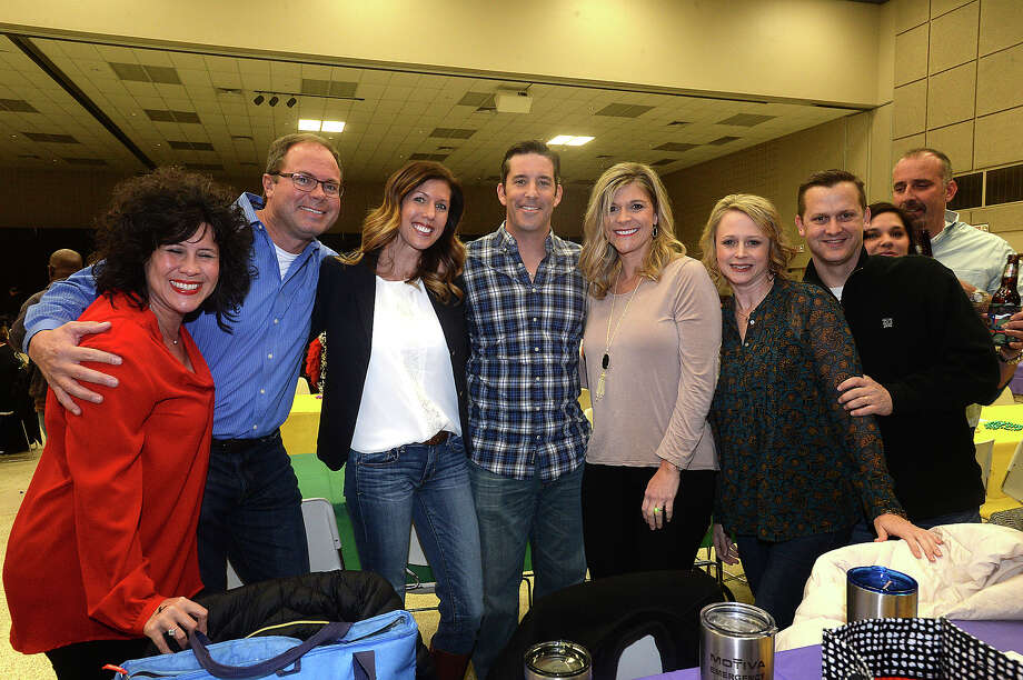 Kristi Guilbeaux, James and Paisley Ware, Bryan and LaRae Bost, Angie and Michael Melancon, and Regina and Brian Landry were at the fifth annual Beans and Jeans fundraising party held Saturday night at the Bob Bowers Civic Center in Port Arthur. The event coincides with Three Kings' Day, which officially ends the Christmas season and kicks off the start for Mardi Gras season. Revelers got in the spirit, celebrating with red beans and rice, king cake and musical entertainment by Electric Circus as the Krewes for this year's 25th Mardi Gras of Southeast Texas were introduced. The season reaches its climax with the weekend-long party and parades in downtown Port Arthur that begins February 23. Photo taken Saturday, January 7, 2017 Kim Brent/The Enterprise Photo: Kim Brent / Beaumont Enterprise