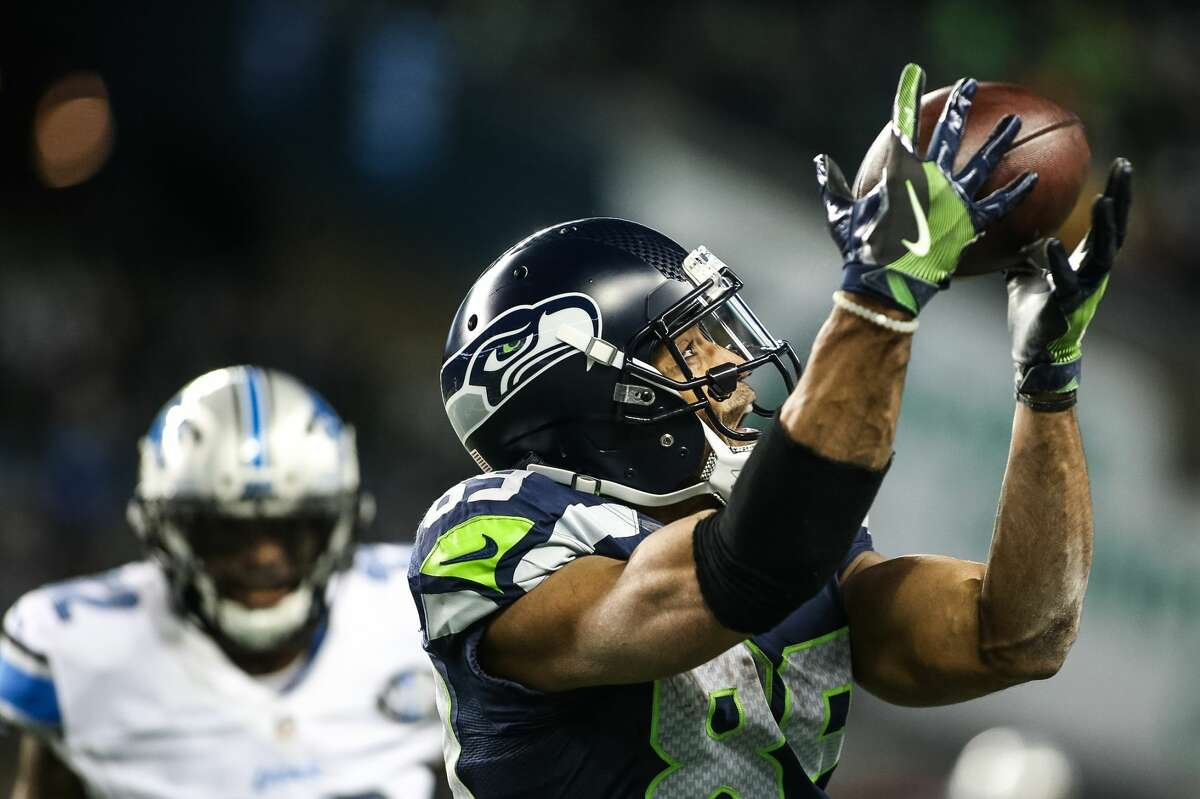 Seahawks receiver Doug Baldwin hauls in a 42-yard catch from Russell Wilson during a fourth-quarter scoring drive.