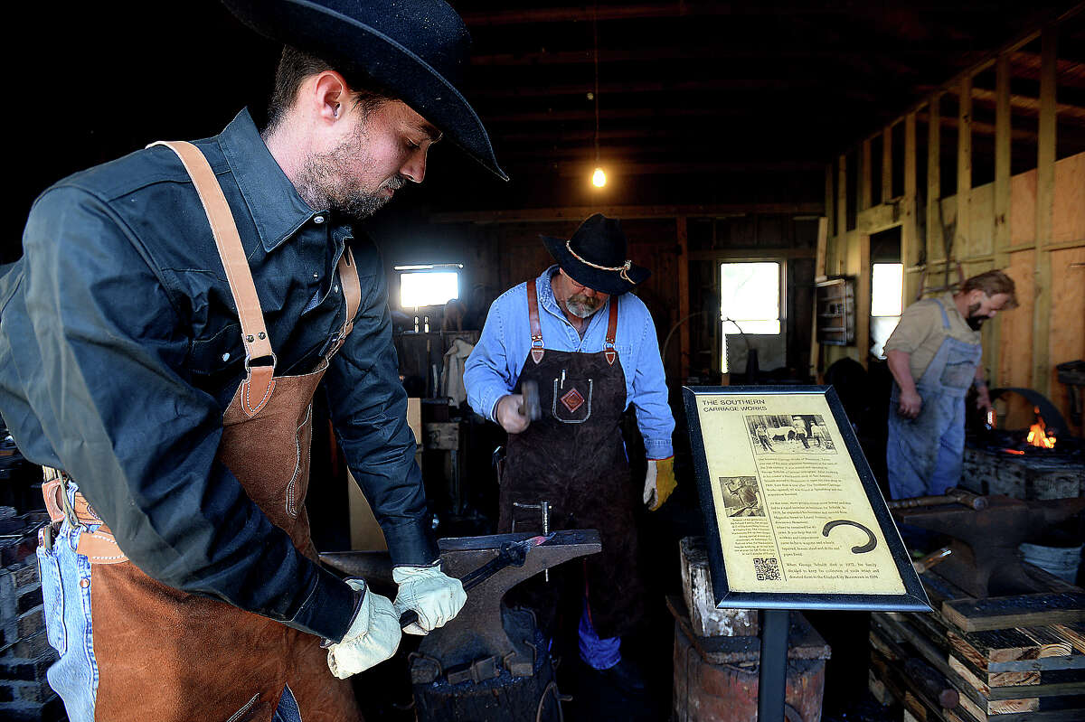 From left, Kevin Watts, father Duane Watts, and Rob Flurry forge iron pieces at a demonstration in the Southern Carriage Works building during the Driller's Reunion : Spindletop's 116th Anniversary Celebration Saturday at the Spindletop - Gladys City Boomtown Museum. Re-enactors with BigThicket Outlaws added character to the day-long event, hosting tea parties, offering demonstrations, and performing shoot-outs in the town square, bringing to life the people and culture of Gladys City in its gusher heyday. Photo taken Saturday, January 7, 2017 Kim Brent/The Enterprise