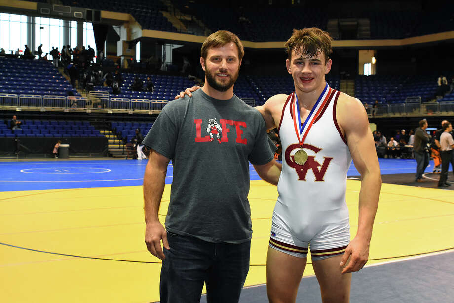 Cy Woods' Henry Rossiter, who finished first in the Boys 182 weight class at the CFISD Invitational Saturday, stands beside head coach Michael White following his victory. Rossiter defeated Summer Creek's Nathaniel Schutt to win first place in his bracket. Photo: Tony Gaines / HCN