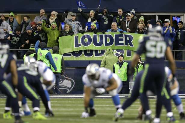 """Seattle Seahawks fans yell behind a banner that reads """"Louder"""" during the first half of an NFL football NFC wild card playoff game against the Detroit Lions, Saturday, Jan. 7, 2017, in Seattle. (AP Photo/Stephen Brashear)"""
