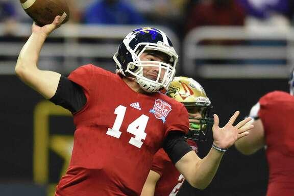 East quarterback Josh Adkins of Smithson Valley throws during the San Antonio Sports All-Star Game at the Alamodome on Jan. 7, 2017.