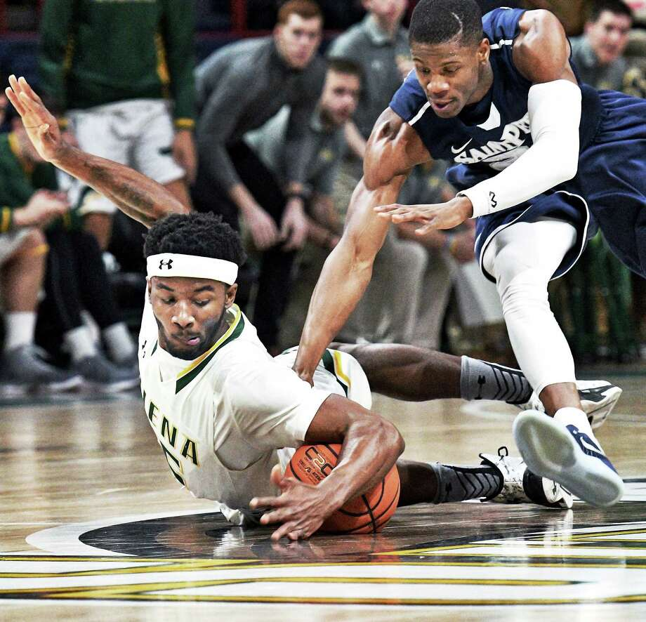 Siena's #15 Nico Clareth, left, and Saint Peter's #20 Chazz Patterson chase a loose ball during Saturday's game at the Times Union Center Jan. 7, 2017 in Albany, NY.  (John Carl D'Annibale / Times Union) Photo: John Carl D'Annibale / 20039264A