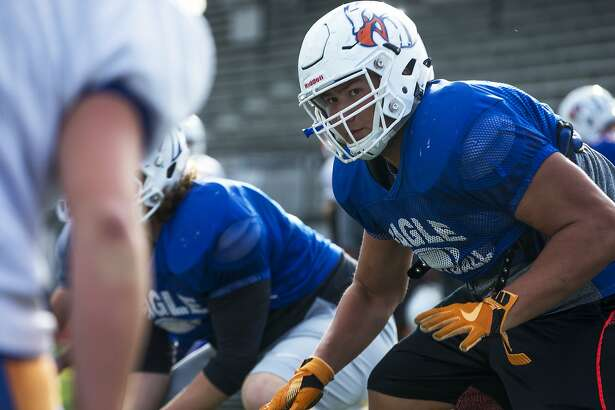 Graham-Kapowsin high schools Foster Sarell, who is the top-rated high school offensive lineman in the nation, runs drills during practice at Bethel High School in Spanaway on Tuesday, 25, 2016.