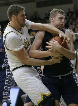 St. Mary's center Jock Landale, right, grabs a rebound next to San Francisco center Jimbo Lull during the first half of an NCAA college basketball game in San Francisco, Saturday, Jan. 7, 2017. (AP Photo/Jeff Chiu)