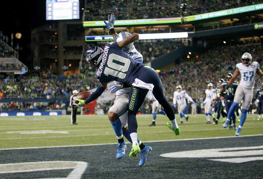 Seahawks receiver Paul Richardson reels in a one-handed TD catch despite a lot of contact with Lions safety Tavon Wilson in the NFC wild-card matchup. Photo: Otto Greule Jr, Stringer / 2017 Getty Images