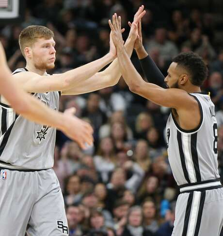 San Antonio Spurs' Davis Bertans (left) celebrates his 3-pointer with teammate Patty Mills during second half action against the Charlotte Hornets Saturday Jan. 7, 2017 at the AT&T Center. The Spurs won 102-85. Photo: Edward A. Ornelas/San Antonio Express-News