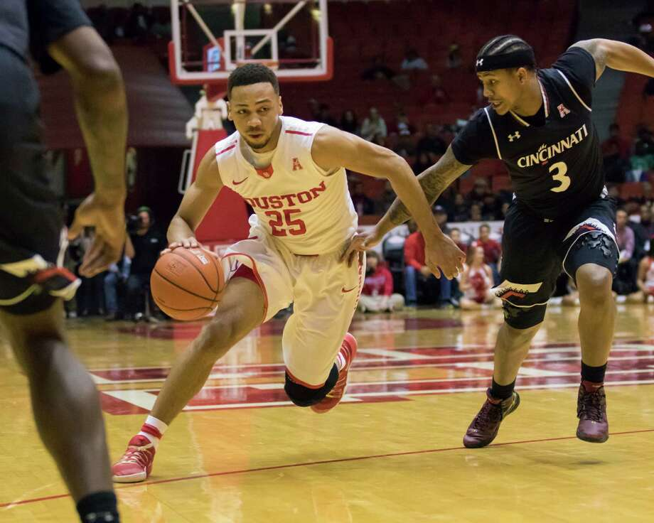 Houston's Galen Robinson (25) drives the ball past Cincinnati's Justin Jenifer in the first half of an NCAA college basketball game Saturday, Jan. 7, 2017, in Houston. (AP Photo/Joe Buvid) Photo: Joe Buvid, FRE / FR171467 AP