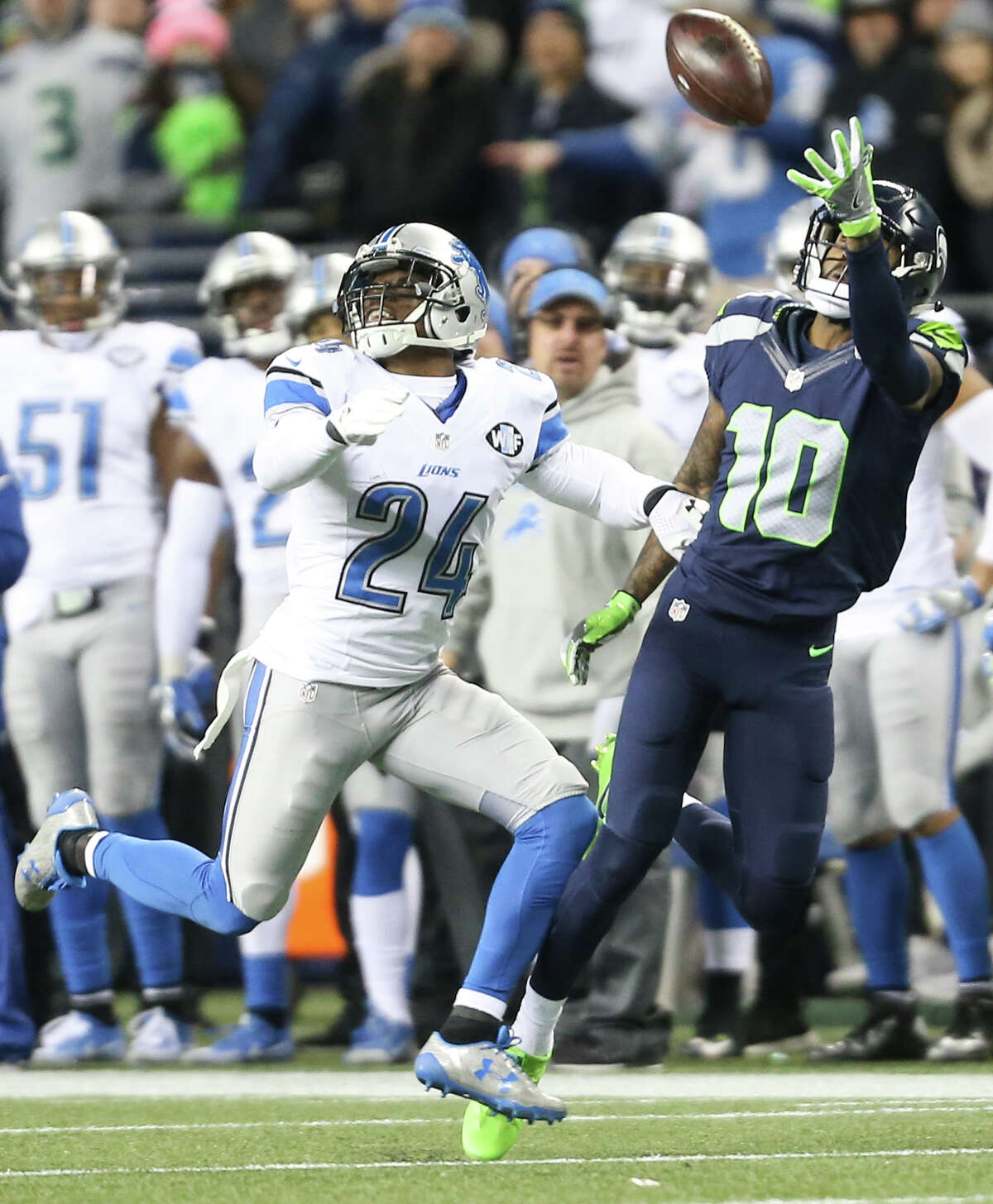 Seahawks wide receiver Paul Richardson makes a one-handed catch while being guarded by Lions corner back Nevin Lawson during the second half of a wild card playoff game at CenturyLink Field on Saturday, Jan. 7, 2017.