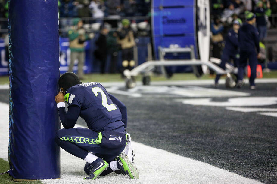 Seahawks quarterback Trevone Boykin prays before playing the Detroit Lions in a wild card playoff game at CenturyLink Field on Saturday, Jan. 7, 2017. Photo: GRANT HINDSLEY, SEATTLEPI.COM / SEATTLEPI.COM