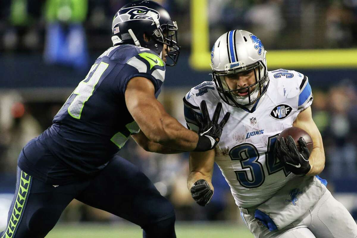 Seahawks linebacker Bobby Wagner pushes Lions running back Zach Zenner out of bounds during the second half of Seattle's NFL wildcard playoff game against Detroit, Saturday, Jan. 7, 2017, at CenturyLink Field.
