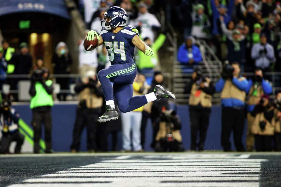 Seahawks running back Thomas Rawls scores a touchdown during the fourth quarter of Seattle's NFL wildcard playoff game against Detroit, Saturday, Jan. 7, 2017, at CenturyLink Field. Photo: GENNA MARTIN, SEATTLEPI.COM / SEATTLEPI.COM