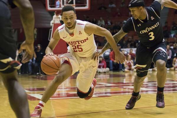 Houston's Galen Robinson (25) drives the ball past Cincinnati's Justin Jenifer in the first half of an NCAA college basketball game Saturday, Jan. 7, 2017, in Houston. (AP Photo/Joe Buvid)