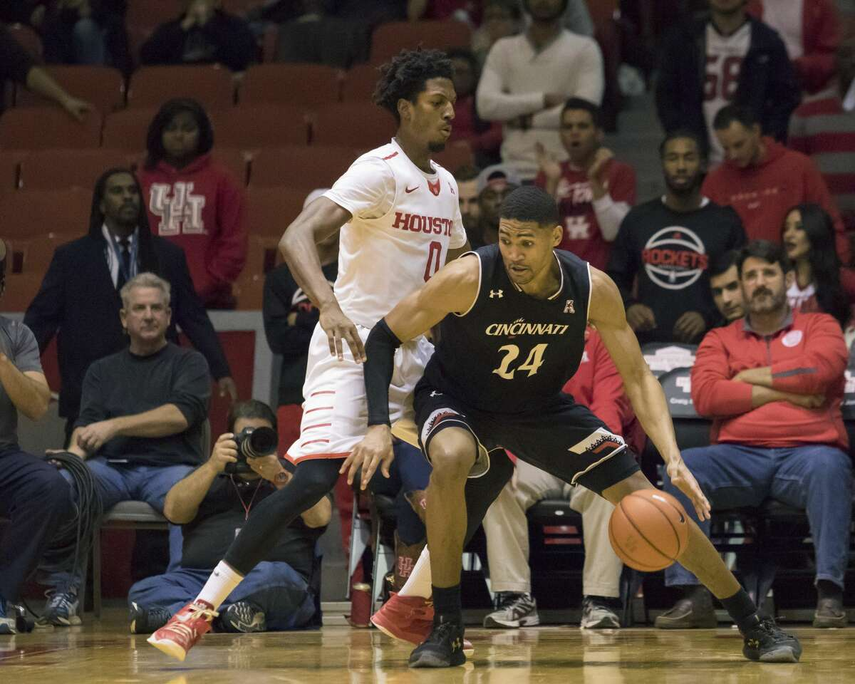 Cincinnati's Kyle Washington (24) dribbles past Houston's Danrad Knowles (0) in the second half of an NCAA college basketball game Saturday, Jan. 7, 2017, in Houston. (AP Photo/Joe Buvid)