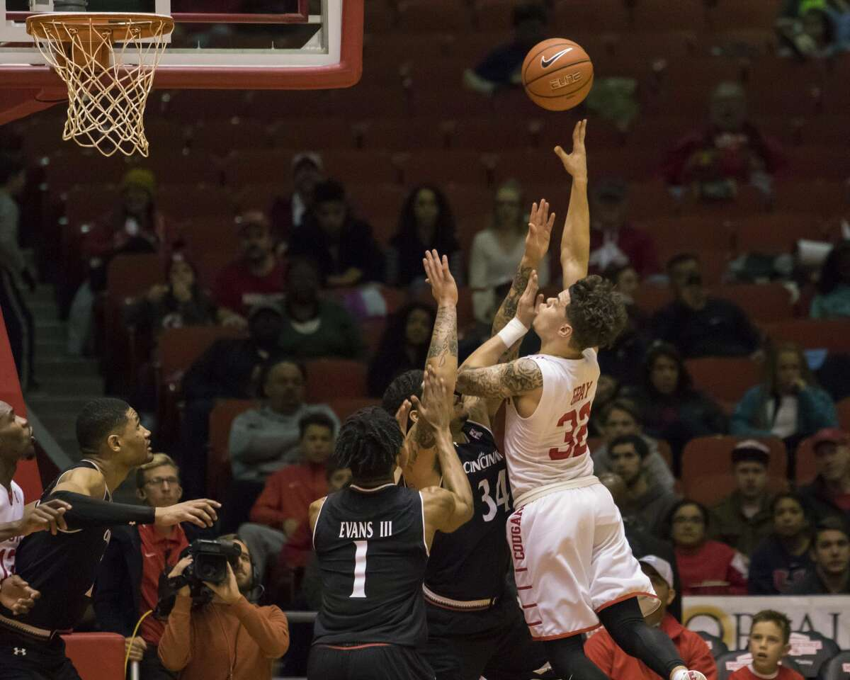 Houston's Rob Gray shoots the ball over Cincinnati's Jarron Cumberland (34) in the second half of an NCAA men's college basketball game Saturday, Jan. 7, 2017, in Houston. (AP Photo/Joe Buvid)