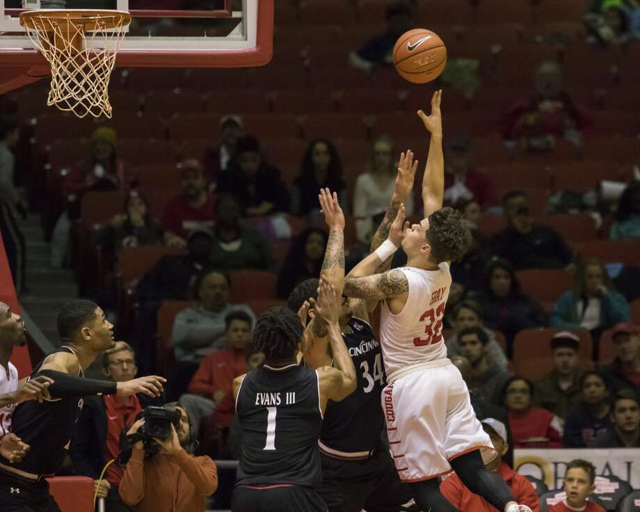 Houston's Rob Gray shoots the ball over Cincinnati's Jarron Cumberland (34) in the second half of an NCAA men's college basketball game Saturday, Jan. 7, 2017, in Houston. (AP Photo/Joe Buvid) Photo: Joe Buvid/Associated Press