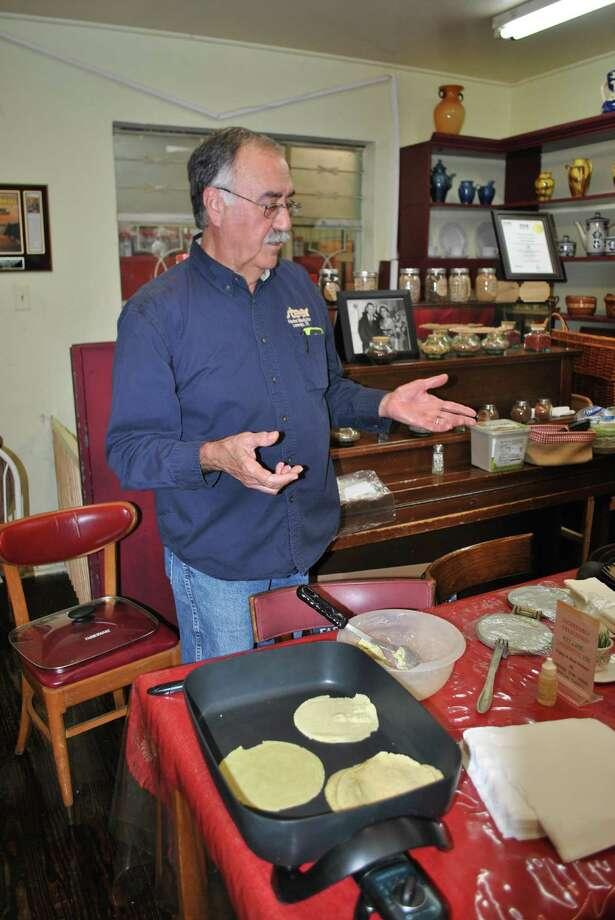 Herbalist Tony Ramirez explains the different ways to prepare the Moringa plant during the Frontera Fusion Herb Workshop while making Moringa Tortillas. Photo: Andrea Castaneda / Laredo Morning Times