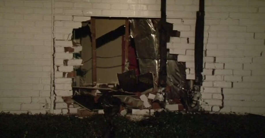 A man is facing charges after barreling through a brick wall overnight. Photo: Metro Video