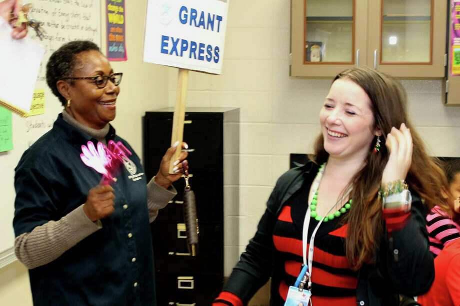 Twin Creeks Middle School teacher Jennifer Ellison reacts as the Spring ISD Education Foundation's Grant Express visits her classroom to fund her grant request. Photo: Submitted