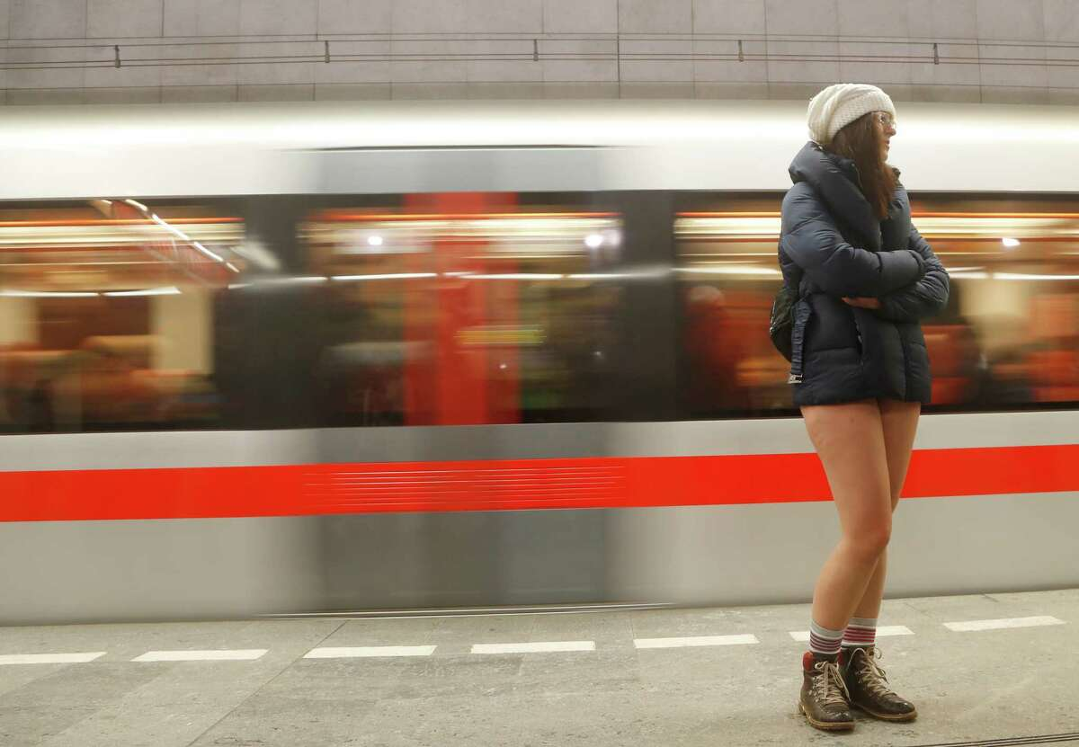 A passenger not wearing pants takes part in the No Pants Subway Ride in Prague, Czech Republic, Sunday, Jan. 8, 2017. The No Pants Subway Ride began in 2002 in New York as a stunt and has taken place in cities around the world since then.