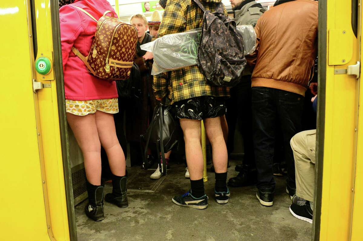 Young people with no pants ride the subway train during the event 'No Pants Subway Ride' in Berlin, Germany, Sunday Jan. 8, 2017. What started in New York City in 2002 with a just a handful of people has blossomed into a worldwide movement involving thousands. No Pants rides are scheduled Sunday in about 50 cities across the U.S., Canada, Europe and Australia. (Maurizio Gambarini/dpa via AP)