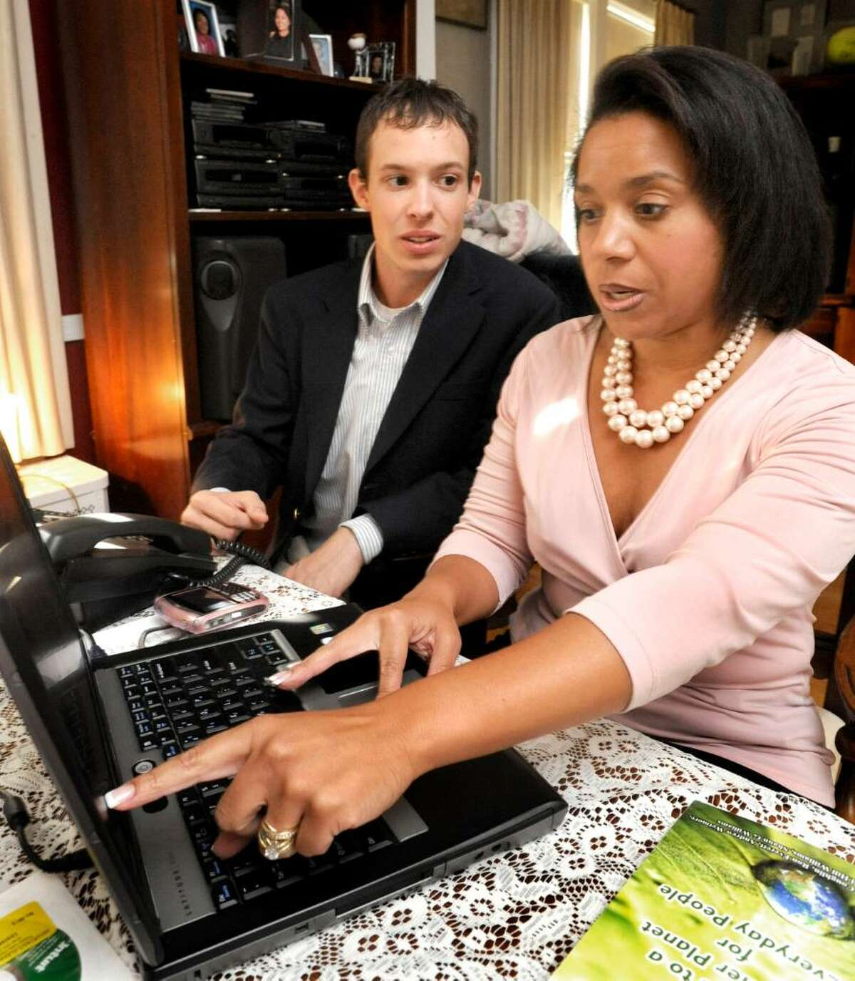 Andrew Wetmore and Gail Hill Williams discuss layout for a book they are co-authoring in Williams home office in danbury on Aug. 31,2009.