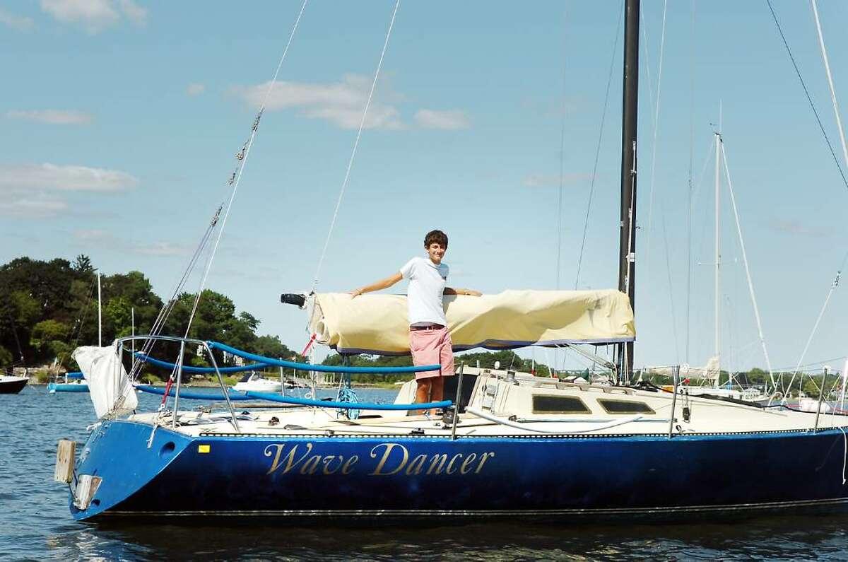 Greenwich High School senior Victor Ansart aboard his Olson 30