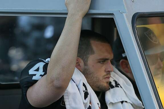 Oakland Raiders quarterback Derek Carr is carted off the field after suffering a broken fibula during action in an NFL game against the Indianapolis Colts on Saturday December 24, 2016 at the Oakland Coliseum in Oakland, CA. The Raiders won 33-25.
