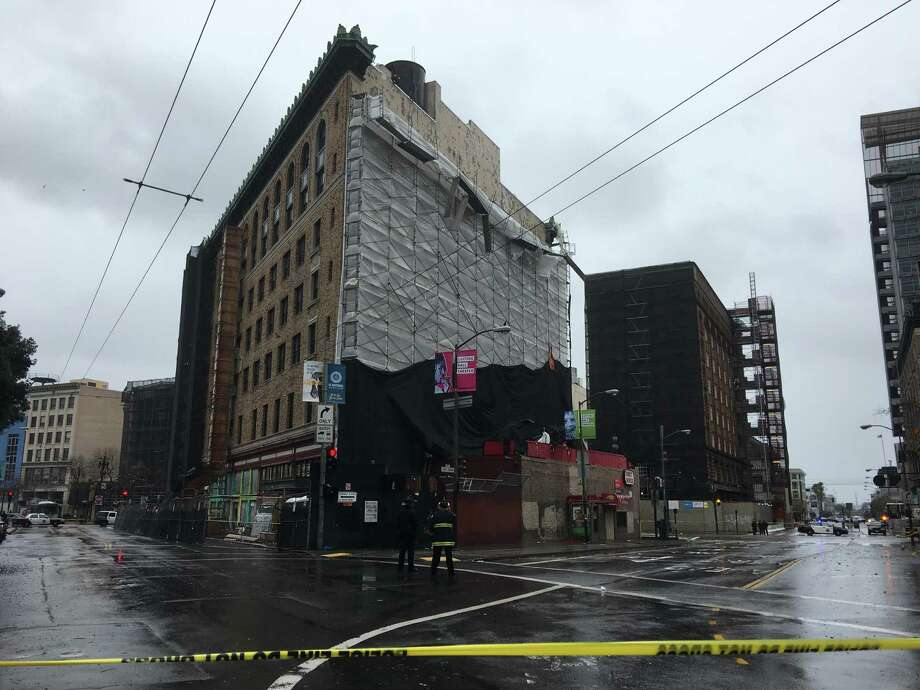 The collapse of scaffolding materials Sunday afternoon shut down several blocks of Market Street. Photo: Kimberly Veklerov / The Chronicle