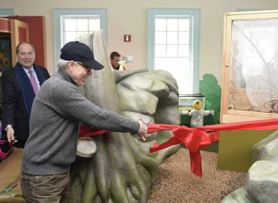 Fashion designer Tommy Hilfiger, a Greenwich resident, cuts the ribbon of the Hilfiger Learning Center at Audubon Greenwich in Greenwich, Conn. Sunday, Jan. 8, 2017. Audubon Greenwich re-opened the Hilfiger Learning Center, a portion of the main building dedicated to children's education through activities and playing. Hilfiger played a large role in making the learning center a reality, contributing a large financial gift, and was on hand for the ribbon-cutting. Photo: Tyler Sizemore / Hearst Connecticut Media / Greenwich Time