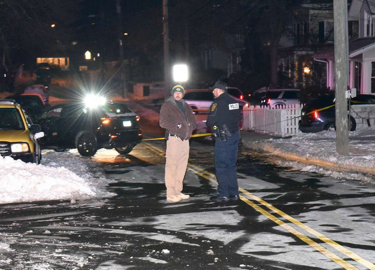 Accident investigator Christopher Wasilewski, left, at the scene Sunday evening, Jan. 8, 2017, with Officer David Nieves.