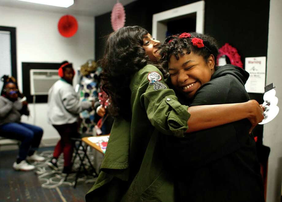 Mentor Crystal Green embraces Amera Porter-Watterson at Workshop Houston. Porter-Watterson has been attending the after-school program at Workshop Houston for several years and is currently learning how to animate. Photo: Annie Mulligan, Freelance / @ 2016 Annie Mulligan & the Houston Chronicle