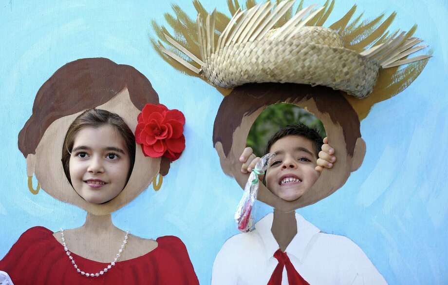 Sema Demirci, 8, (left) and her brother Manuel Demirci, 5,  pose for photos during the Puerto Rican Heritage Society's 23rd annual Three Kings Day held Sunday Jan. 8, 2017 at San Fernando Hall. Photo: Edward A. Ornelas, Staff / San Antonio Express-News / © 2016 San Antonio Express-News