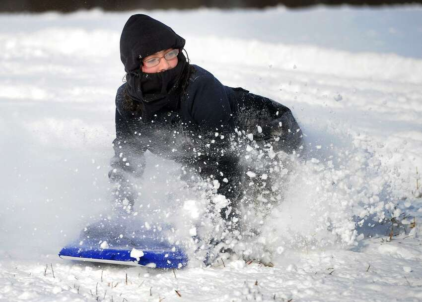 Osbornedale State Park555 Roosevelt Dr, Derby, CT 06418 Iliana Alicea, 10, of Ansonia, kicks up the snow during an afternoon of sledding with her family at Osbornedale State Park in Derby, Conn. on Sunday, January 8, 2016.