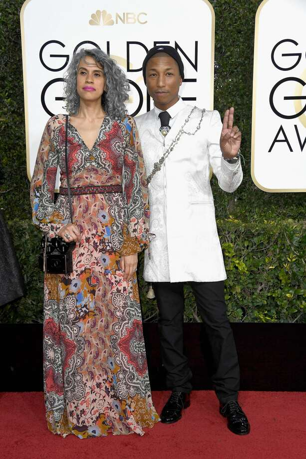 BEVERLY HILLS, CA - JANUARY 08:  Musician Pharrell Williams (R) and Helen Lasichanh attend the 74th Annual Golden Globe Awards at The Beverly Hilton Hotel on January 8, 2017 in Beverly Hills, California.  (Photo by Frazer Harrison/Getty Images) Photo: Frazer Harrison/Getty Images