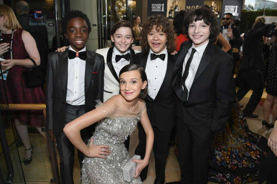 BEVERLY HILLS, CA - JANUARY 08:  (L-R) Actors Caleb McLaughlin, Noah Schnapp, Gaten Matarazzo, Finn Wolfhard, and (bottom) Millie Bobby Brown at the 74th annual Golden Globe Awards sponsored by FIJI Water at The Beverly Hilton Hotel on January 8, 2017 in Beverly Hills, California.  (Photo by Charley Gallay/Getty Images for FIJI Water) Photo: Charley Gallay/Getty Images For FIJI Water