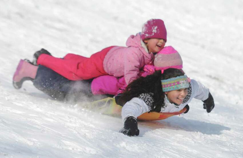 E. Gaynor Brennan Golf Course451 Stillwater Ave, Stamford, CT 06902 Pictured: Sisters Madeline Guarnera, top, 5, Lily Guarnera, 7, and Anabelle Guarnera, 11, of Greenwich, share a sled as they slide down a hill at E. Gaynor Brennan Golf Course in Stamford.