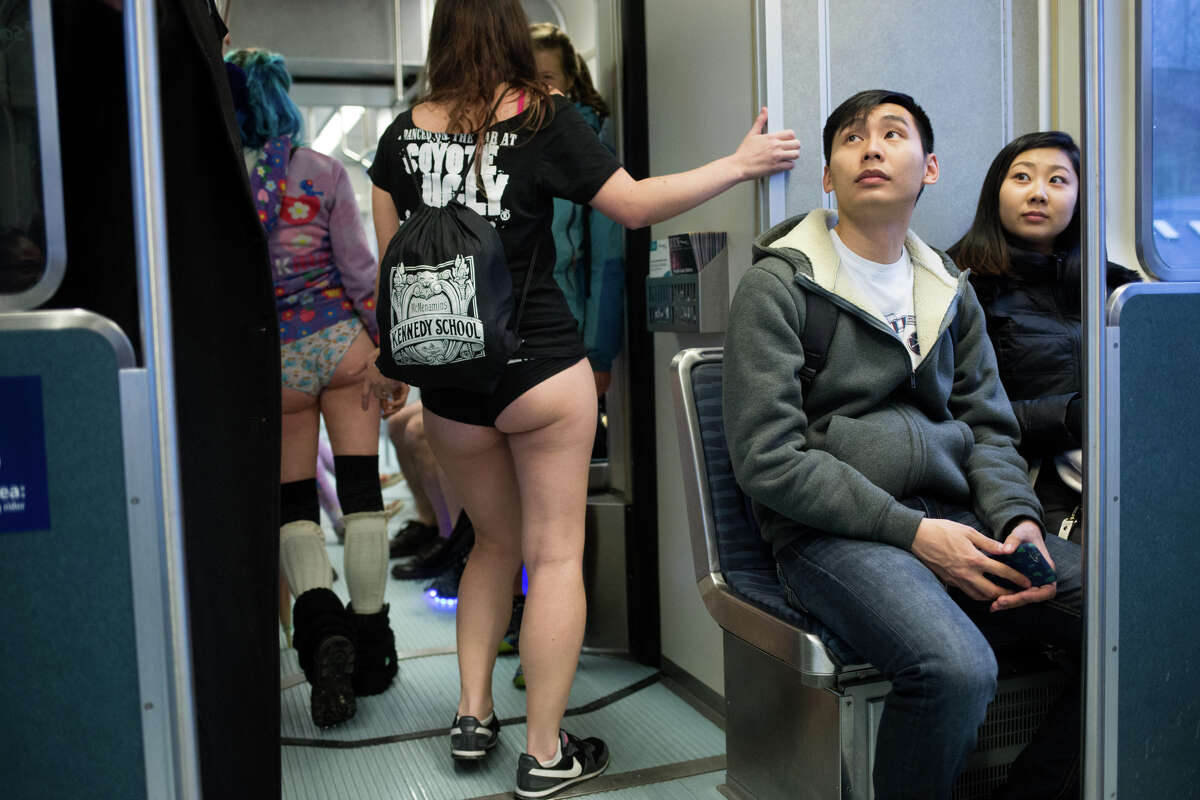 No Pants Light Rail Ride participants share a train car with regular passengers, in Seattle on Sunday, Jan. 8, 2017. A smaller than usual group took part in Seattle's version of the annual, global No Pants Subway Ride that originated in New York City.
