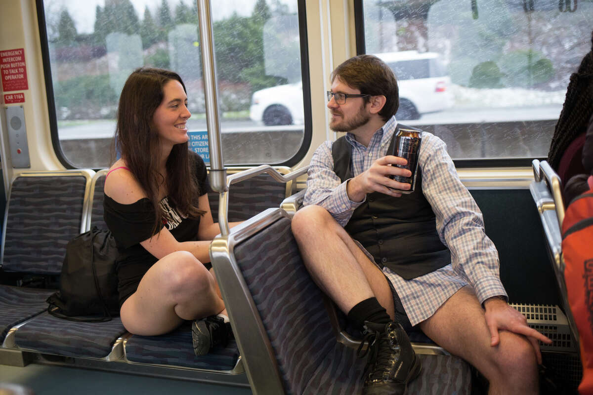 No Pants Light Rail Ride participants talk on the train to the airport, in Seattle on Sunday, Jan. 8, 2017. A smaller than usual group took part in Seattle's version of the annual, global No Pants Subway Ride that originated in New York City.