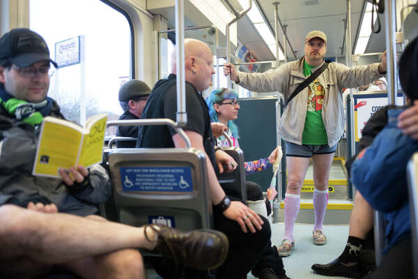 No Pants Light Rail Ride participants ride the train south towards the airport as if fully clothed, in Seattle on Sunday, Jan. 8, 2017. A smaller than usual group took part in Seattle's version of the annual, global No Pants Subway Ride that originated in New York City.