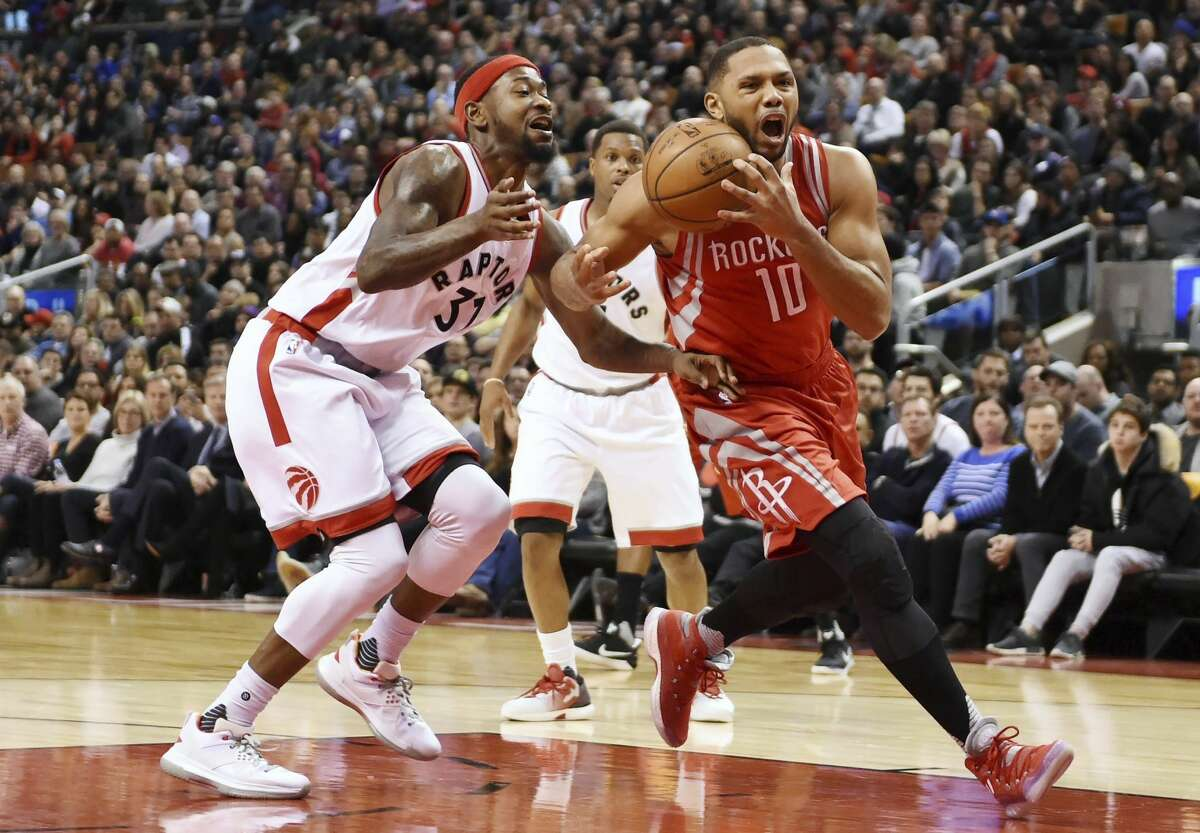 Houston Rockets guard Eric Gordon (10) drives to the net against Toronto Raptors forward Terrence Ross (31) during the second half of an NBA basketball game in Toronto on Sunday, Jan. 8, 2017. (Frank Gunn/The Canadian Press via AP)