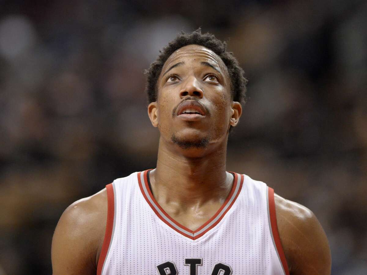 Toronto Raptors guard DeMar DeRozan (10) reacts to a loss to the Houston Rockets following an NBA basketball game in Toronto on Sunday, Jan. 8, 2017. (Frank Gunn/The Canadian Press via AP)