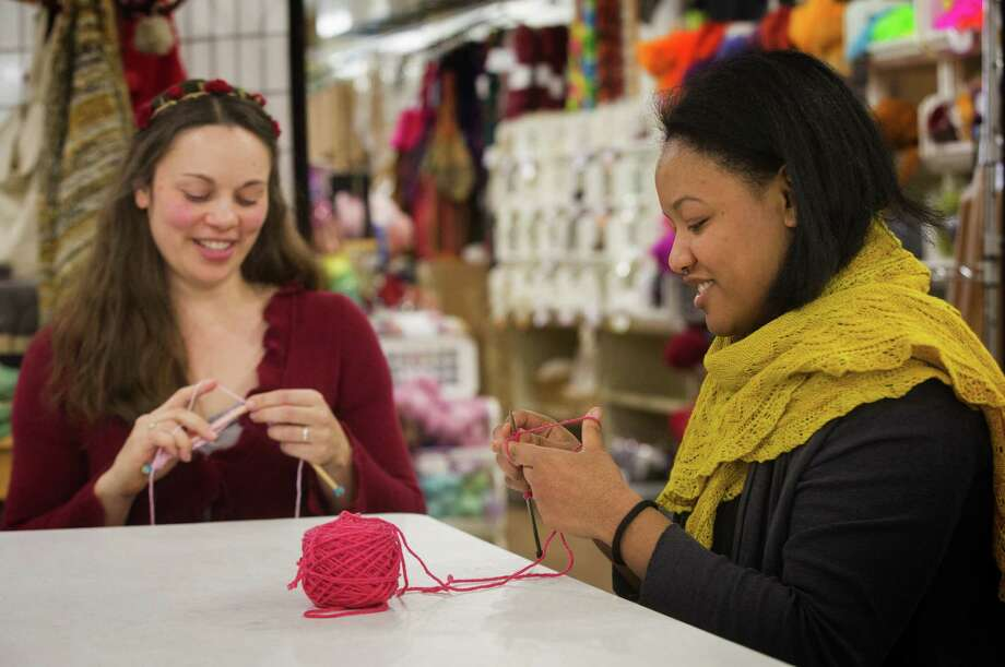 Jennifer Miller, left, a yarn wrangler, and Jessica Owens, manager of Weaving Works in Seattle, Wash. get started on knitting Pussyhats for women to wear at the Women's March on Washington. (Ellen M. Banner/Seattle Times/TNS) Photo: Ellen M. Banner, MBR / Seattle Times