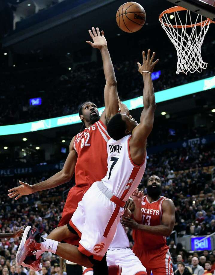 Toronto Raptors guard Kyle Lowry (7) is fouled by Houston Rockets center Nene Hilario (42) during first-half NBA basketball game action in Toronto, Sunday, Jan. 8, 2017. (Frank Gunn/The Canadian Press via AP) Photo: Frank Gunn, SUB / The Canadian Press